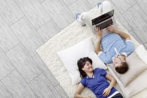 Beautiful couple smiling lying on the floor